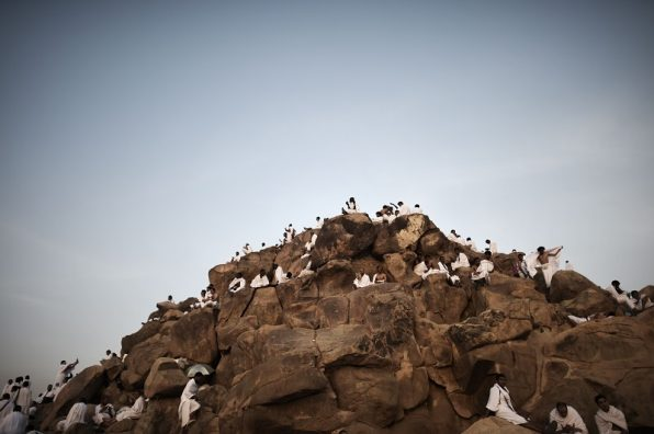 Muslim pilgrims gather on Mount Arafat near Mecca as they perform one of the Hajj rituals late on October 3, 2014. The pilgrims perform a series of rituals during the annual Hajj. They circumambulate the kaaba seven times, runs back and forth between the hills of Al-Safa and Al-Marwah, drink from the Zamzam Well, goes to the plains of Mount Arafat to stand in vigil, and throws stones in a ritual Stoning of Devil. The pilgrims then shave their heads, perform a ritual of animal sacrifice, and celebrate Eid al-Adha holiday. AFP PHOTO/MOHAMMED AL-SHAIKH